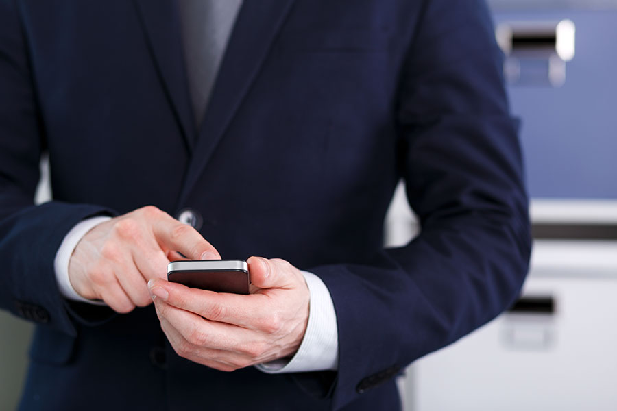 CEO-Holding-A-Cell-Phone